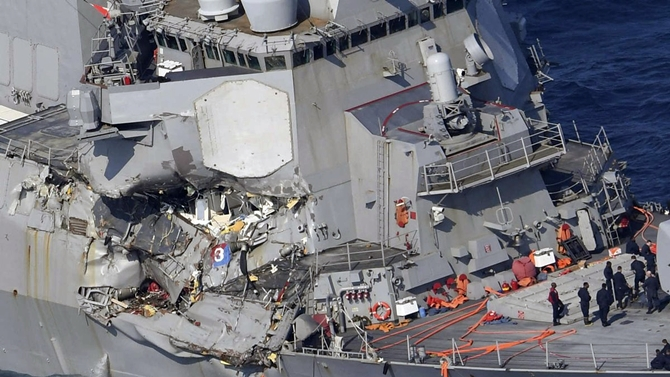 US navy destroyer collides with container ship