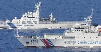 Çin tartışmalı adalara silahlı gemi gönderdi